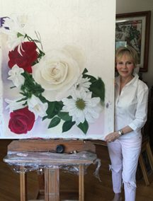Showing the impressive size of the painting in progress.